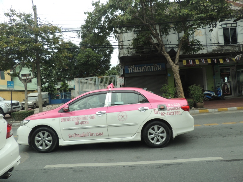 A pink taxi on the streets of bangkok.... I liked it
